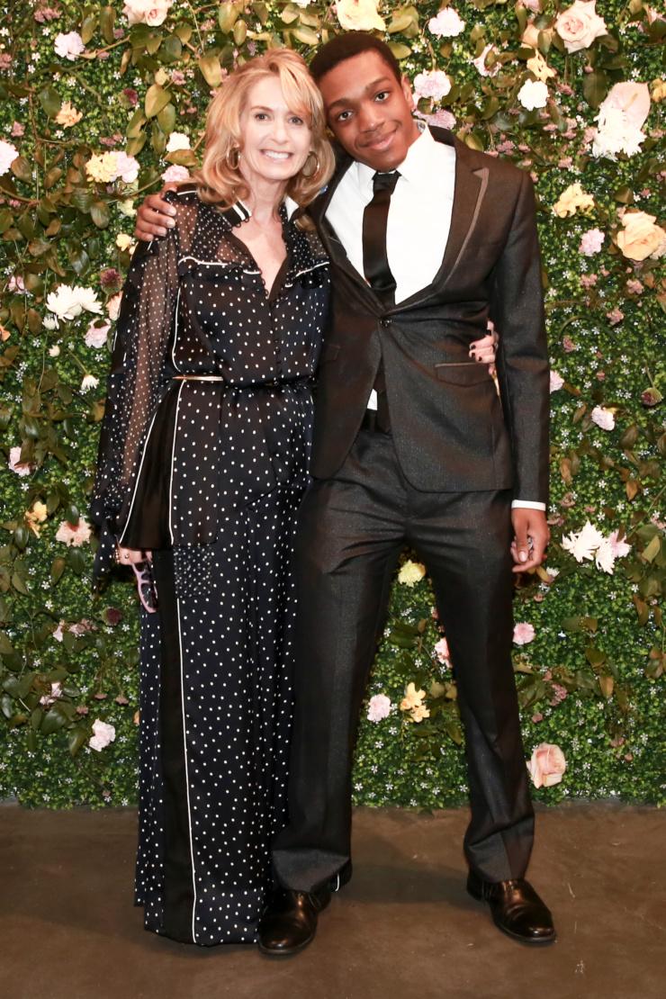 Adonai and Liz Hopfan wearing Sacai