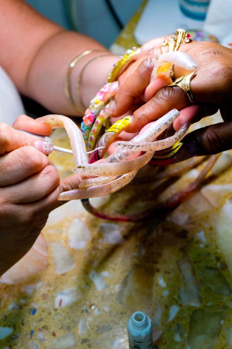Maria painting La Rue's nails