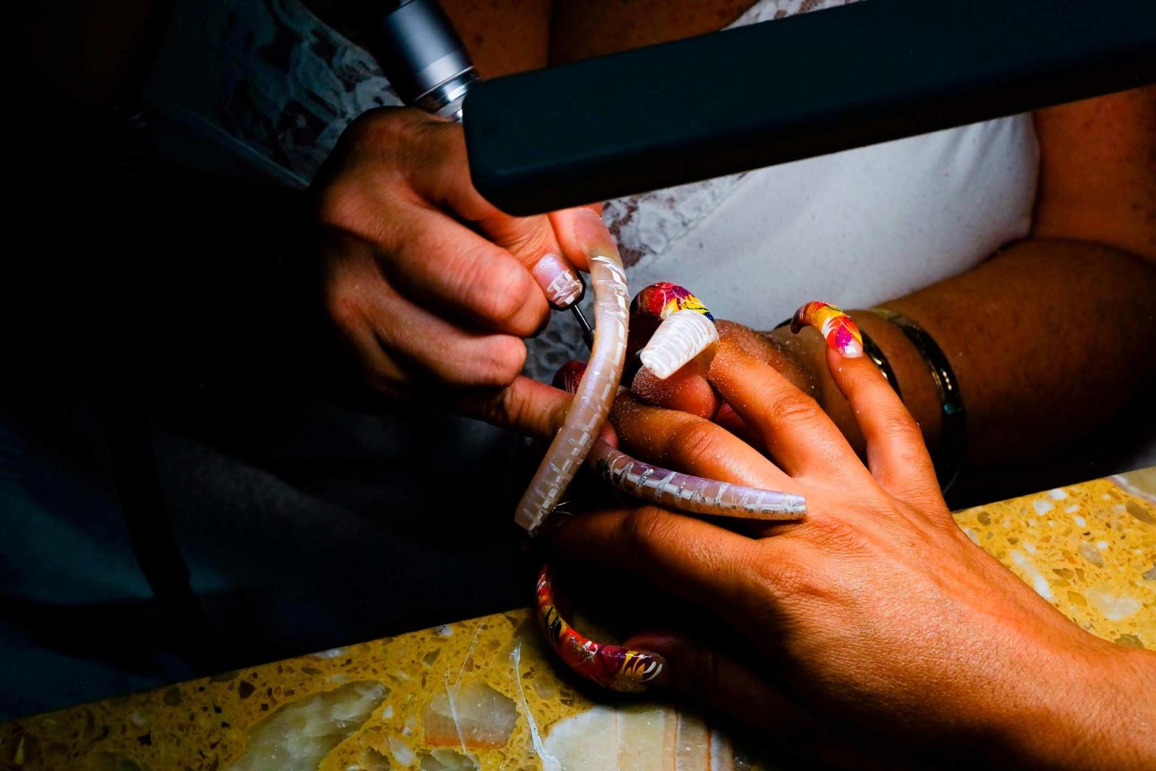 Maria filling in Debbie Warren's nails
