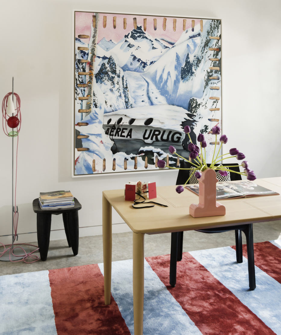 In the office, a painting by Jamian Juliano-Villani hangs on a wall. On the desk is a miniature artist book by Annette Messager and a Shiva vase by Ettore Sottsass.