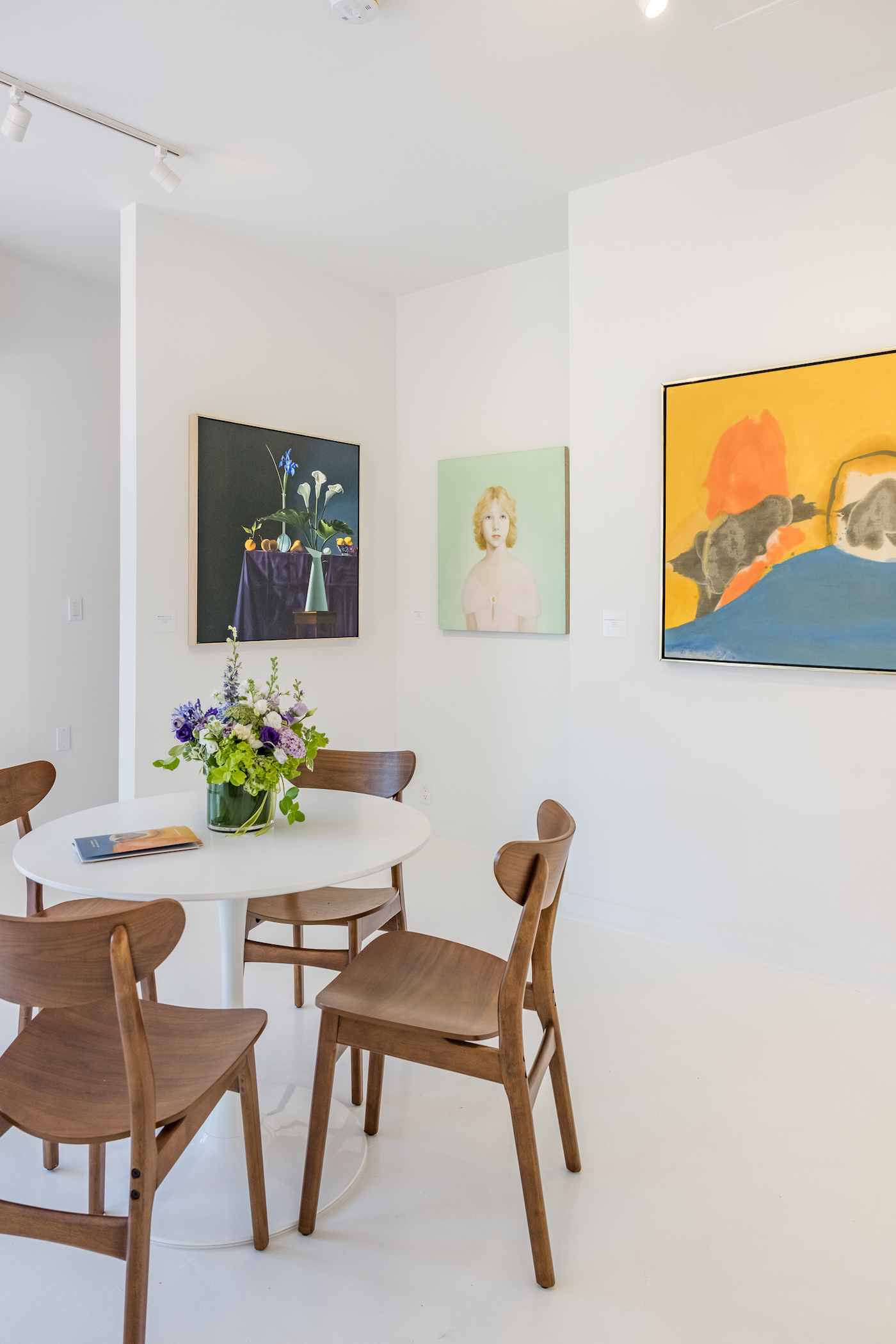 Art gallery space with table and chairs