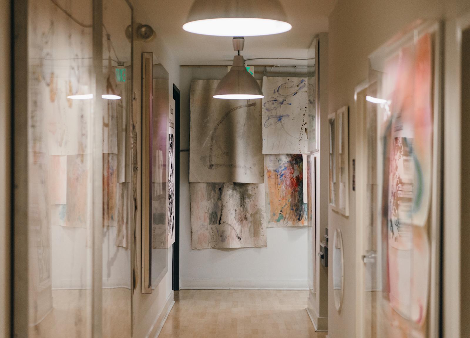 Hallway full of paintings