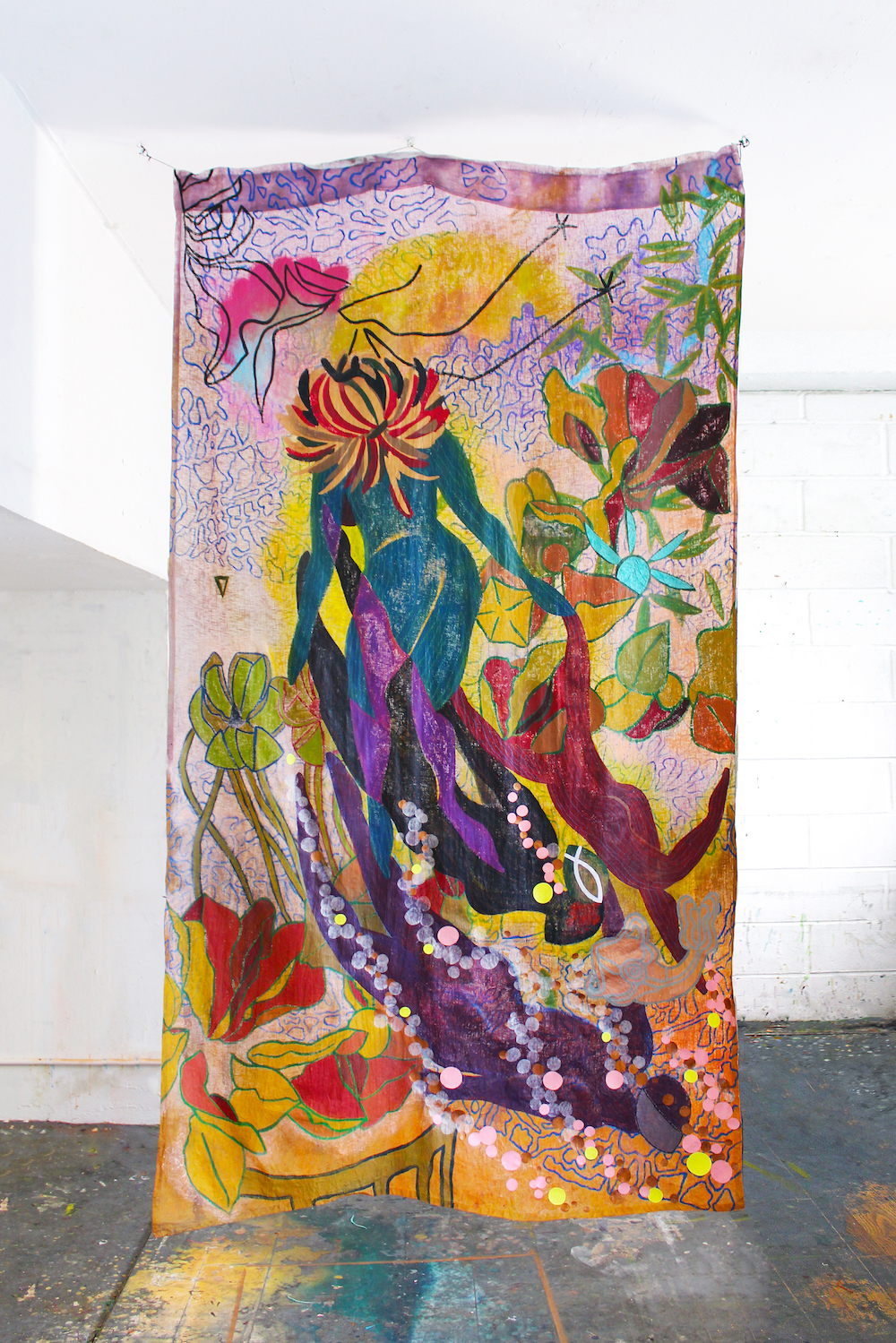 Painting on mixed papers, depicting abstract woman in colors, hanging from ceiling in light-filled space