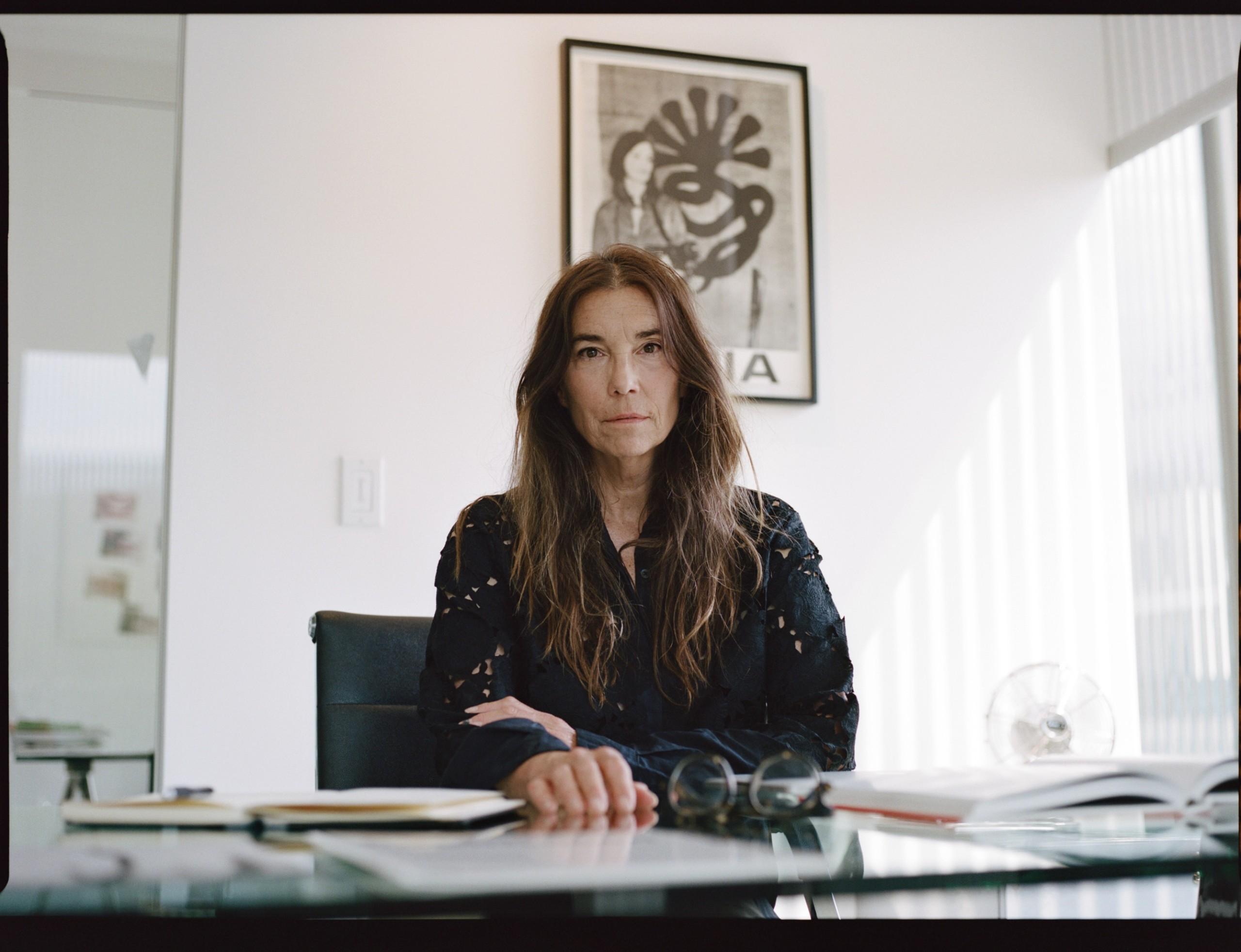 Art dealer sitting at her desk