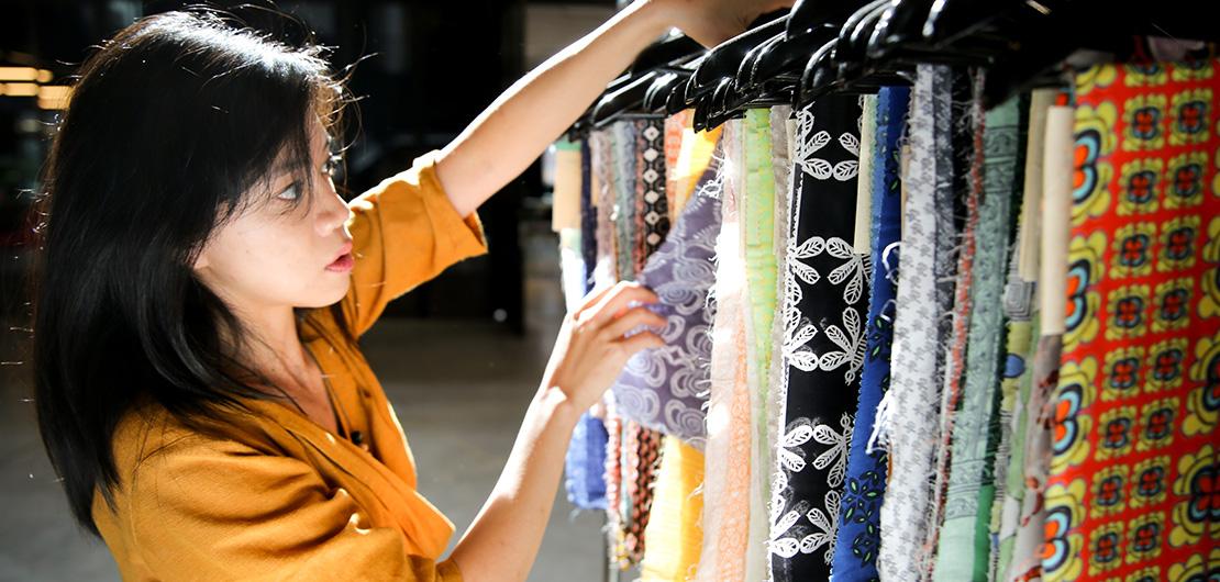 Woman looking at fabrics