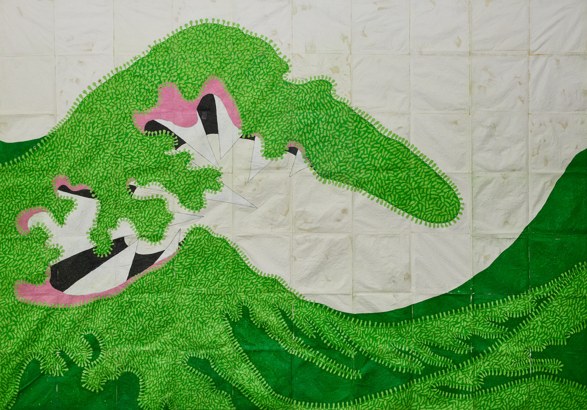 textile work of large green wave reflecting themes of pandemic