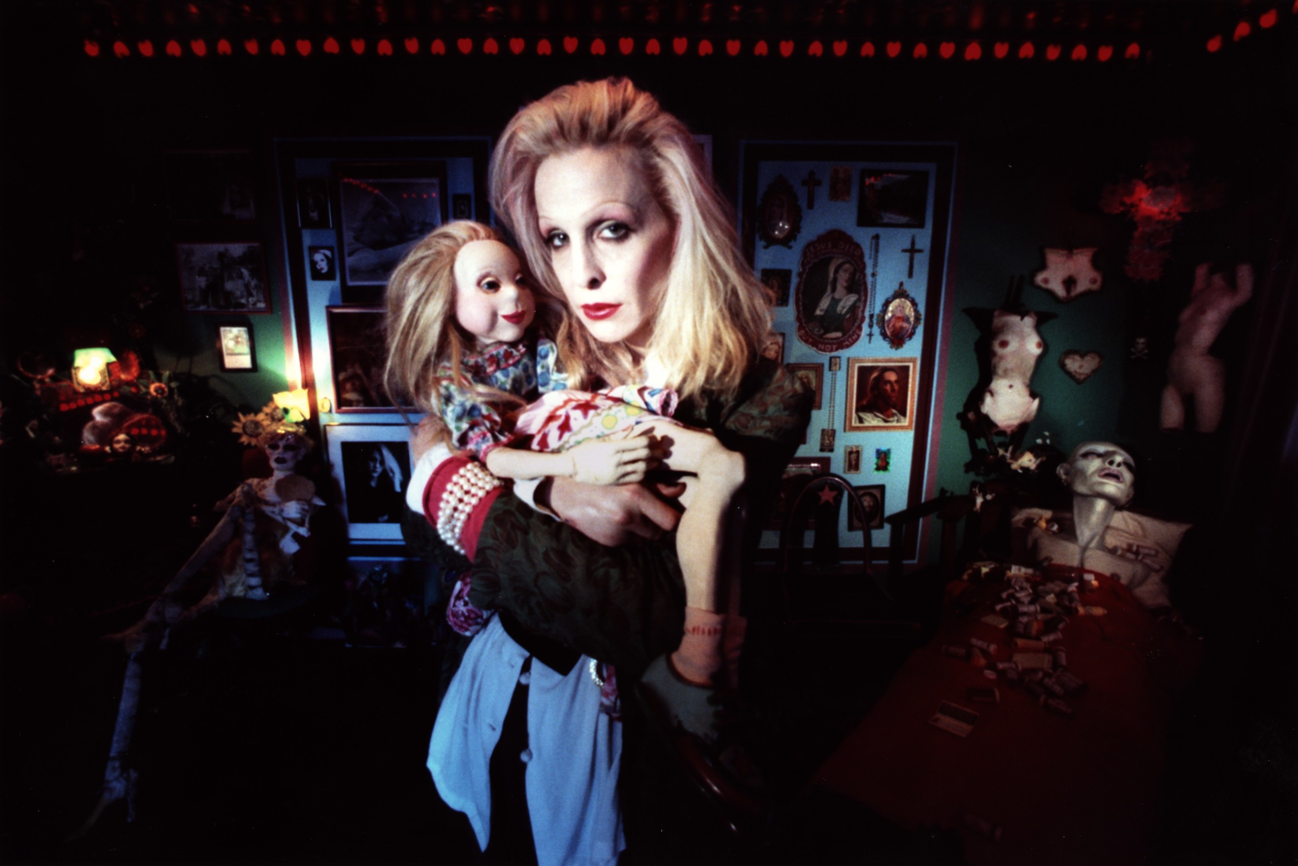 photo of woman with puppet in dark setting