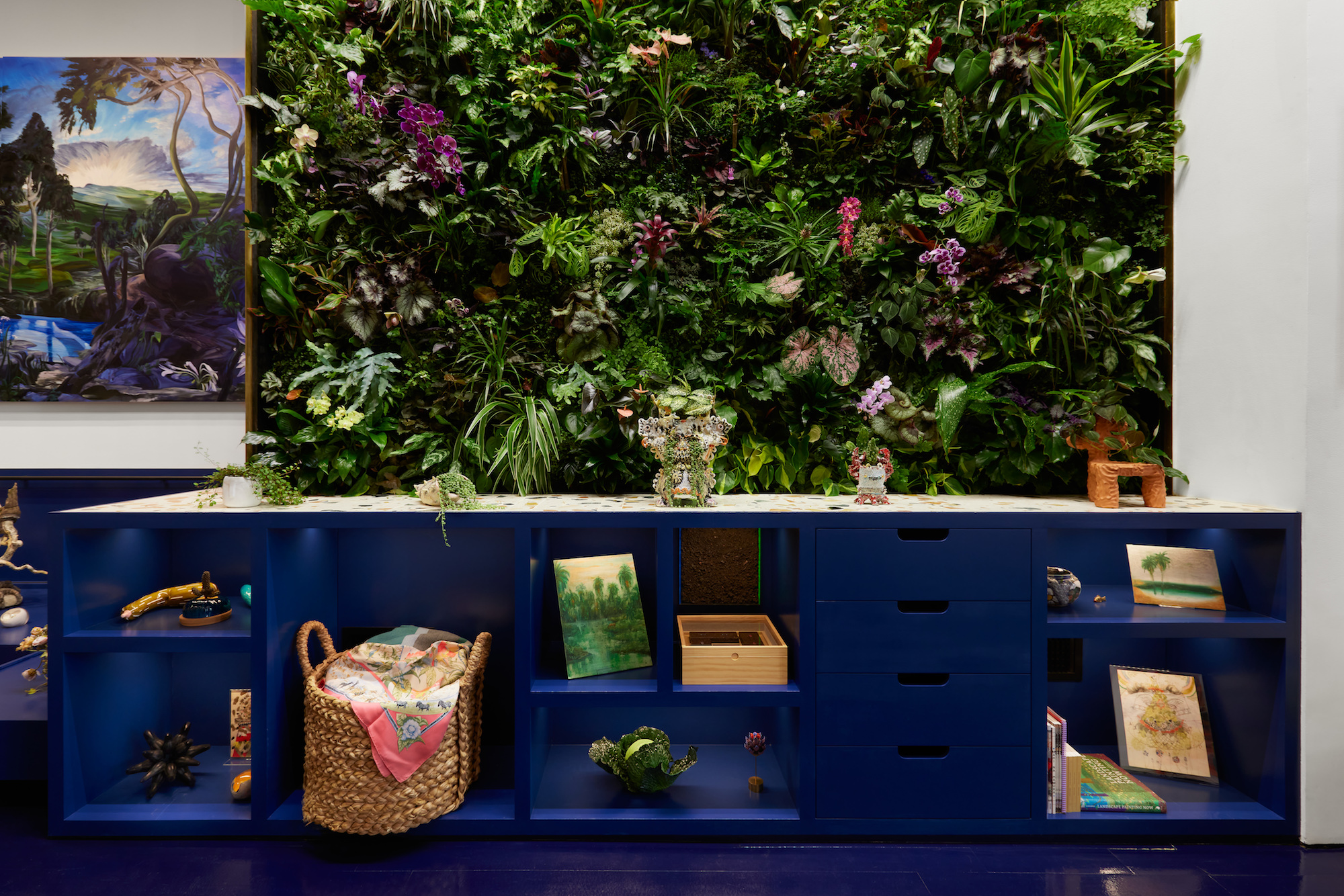 installation view of ridiculous sublime by lisa schiff with large greenery wall by tom colletti