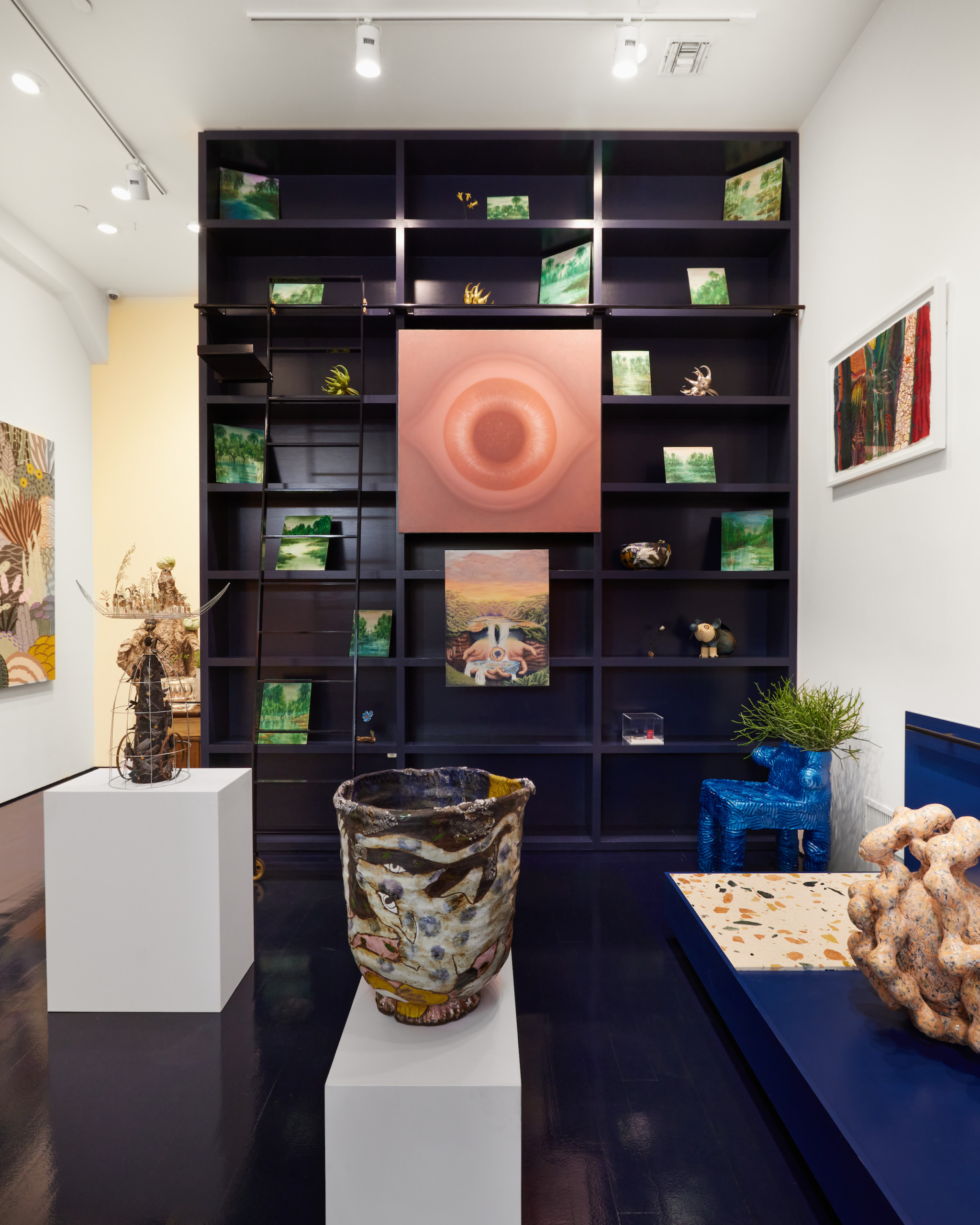 installation view of ridiculous sublime featuring work by Rodolfo Abularach and other artists, with ceramics and paintings