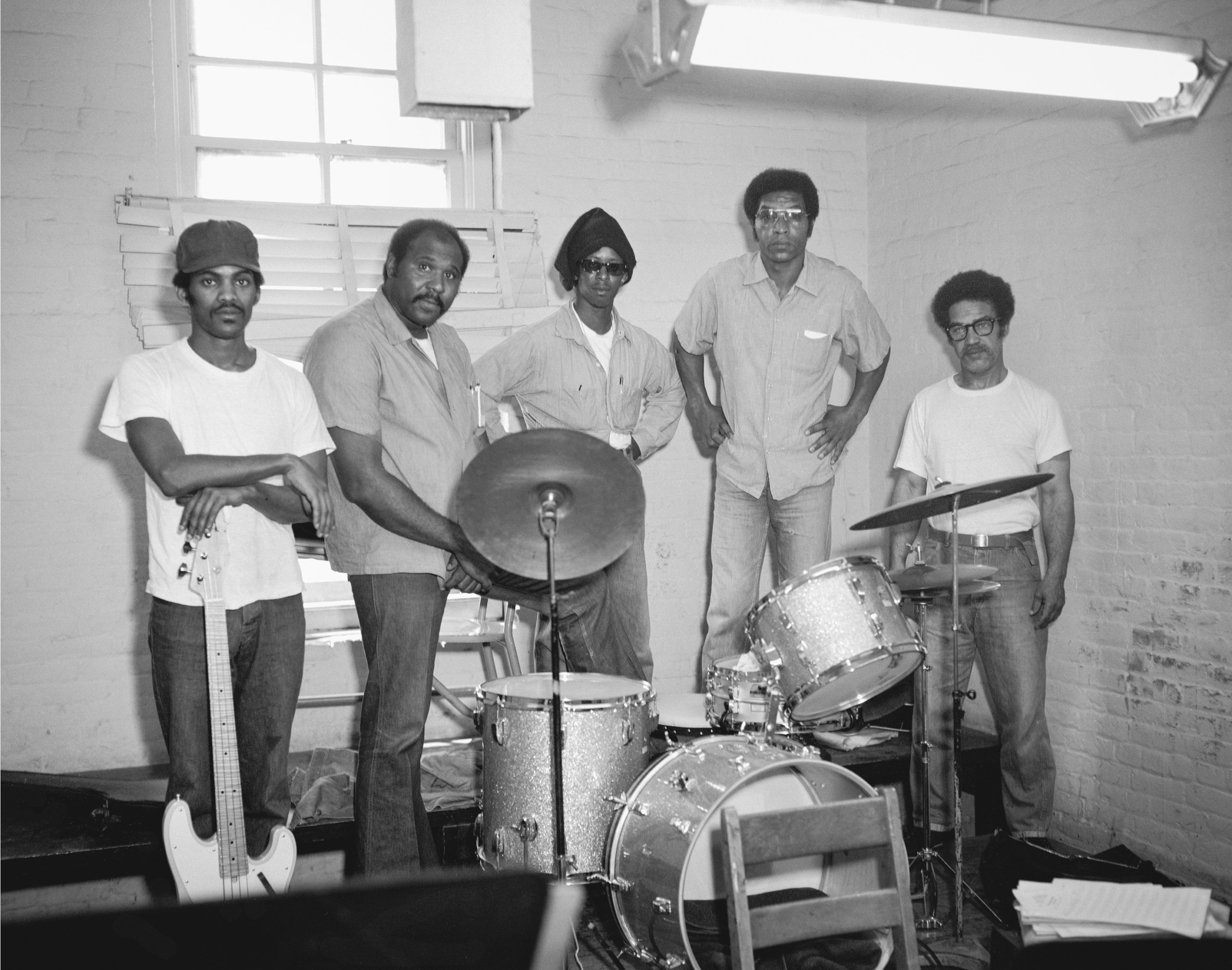 photograph of 5 men with band instruments in prison