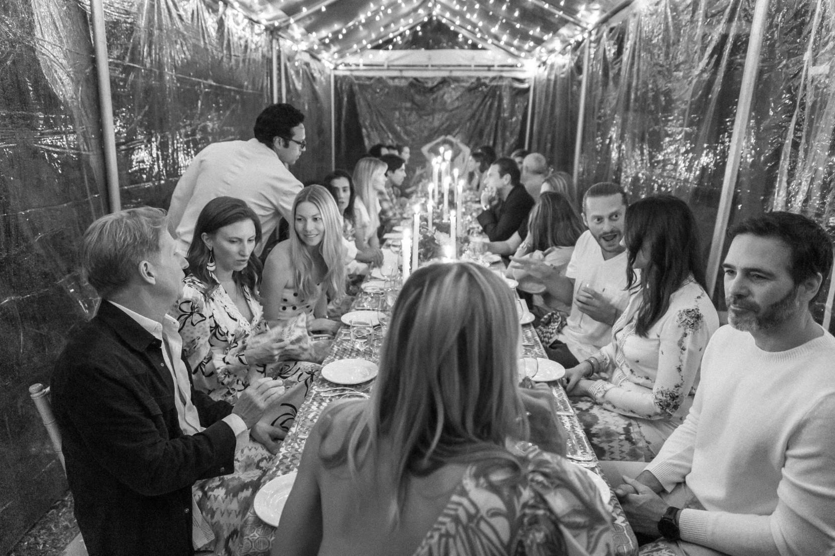 Dinner guests enjoy conversation in Aspen.