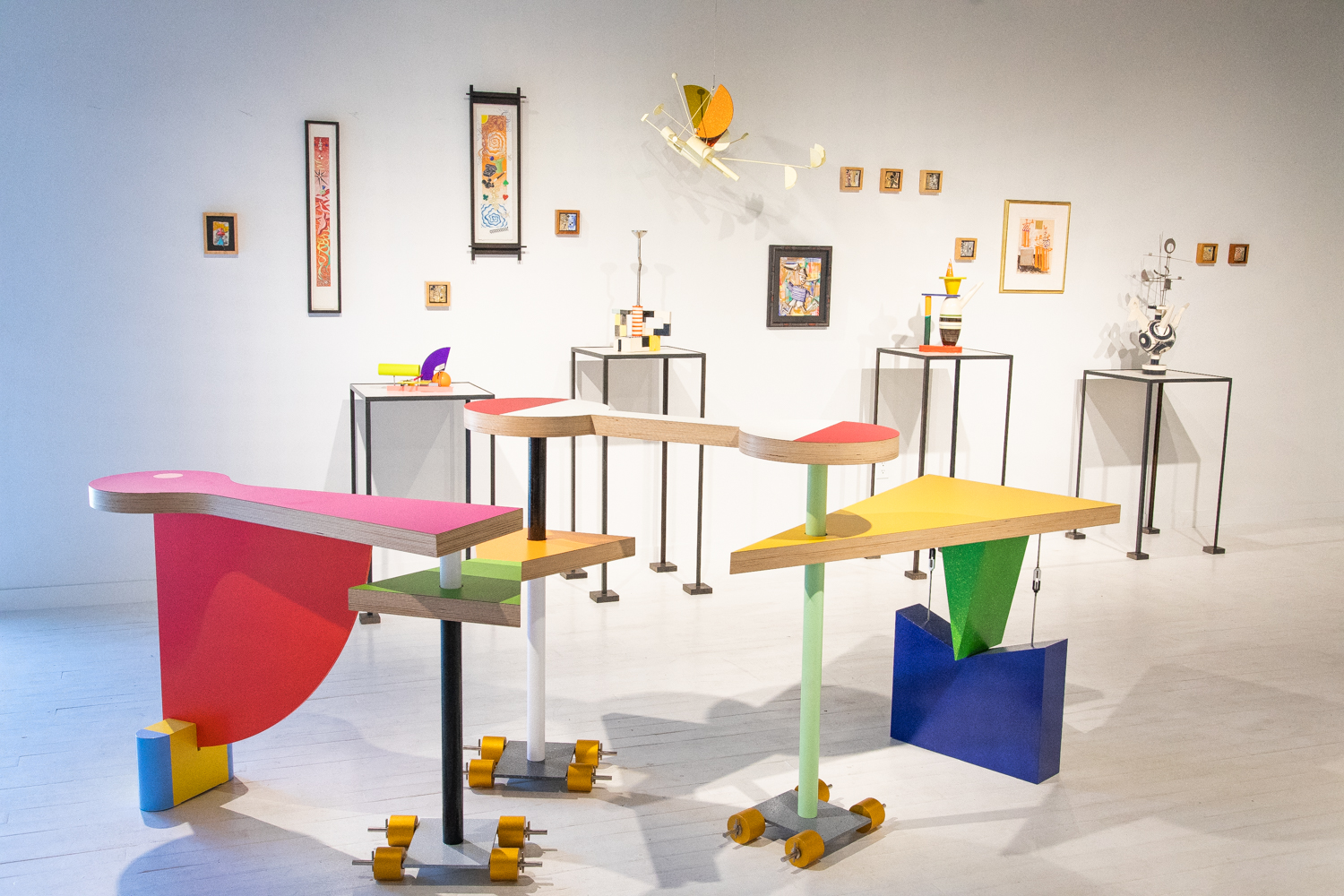 installation view of peter shire show, with modern geometric furniture and art pieces