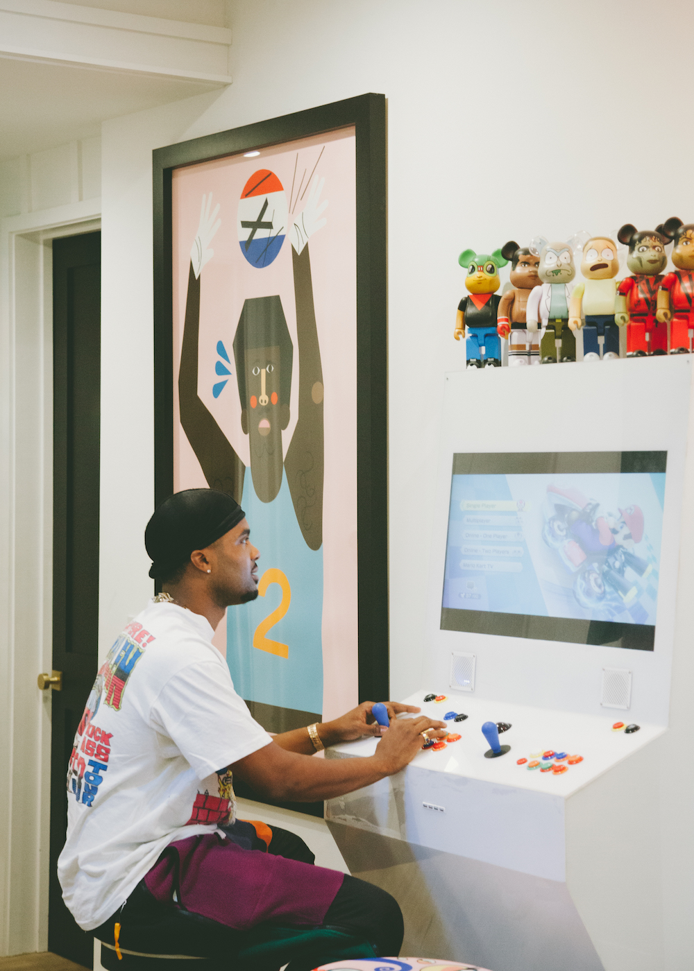 steelo brim playing a video game on white modern looking console