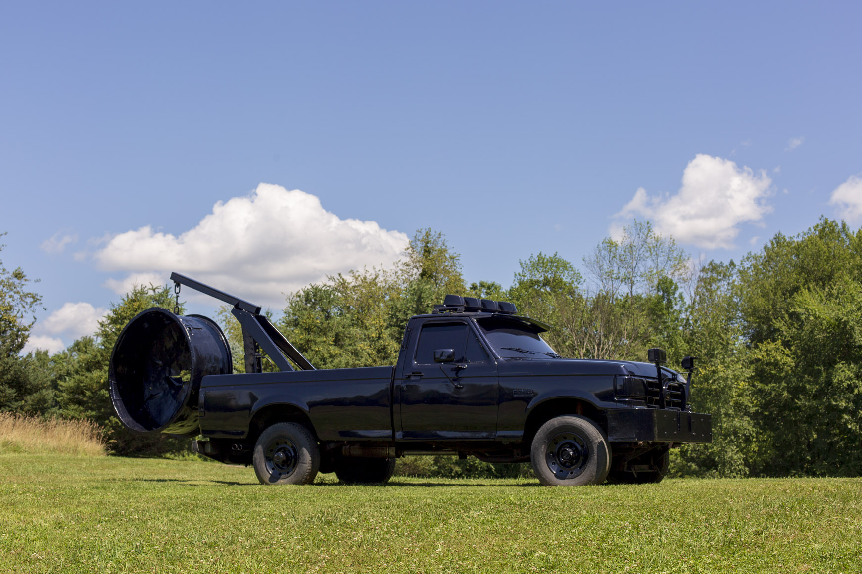 shiny black truck sculpture by virginia overton at the ranch montauk