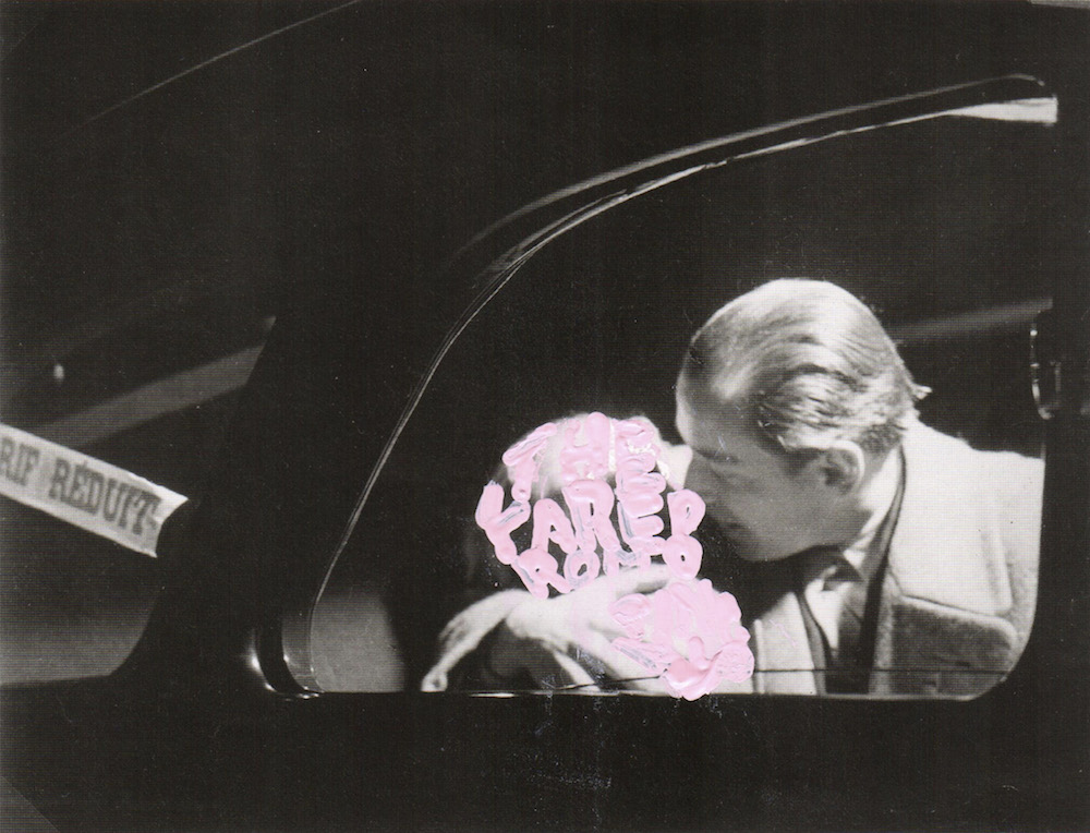 work by betty tompkins of black and white photo of man and woman kissing in a car, woman covered in light pink writing