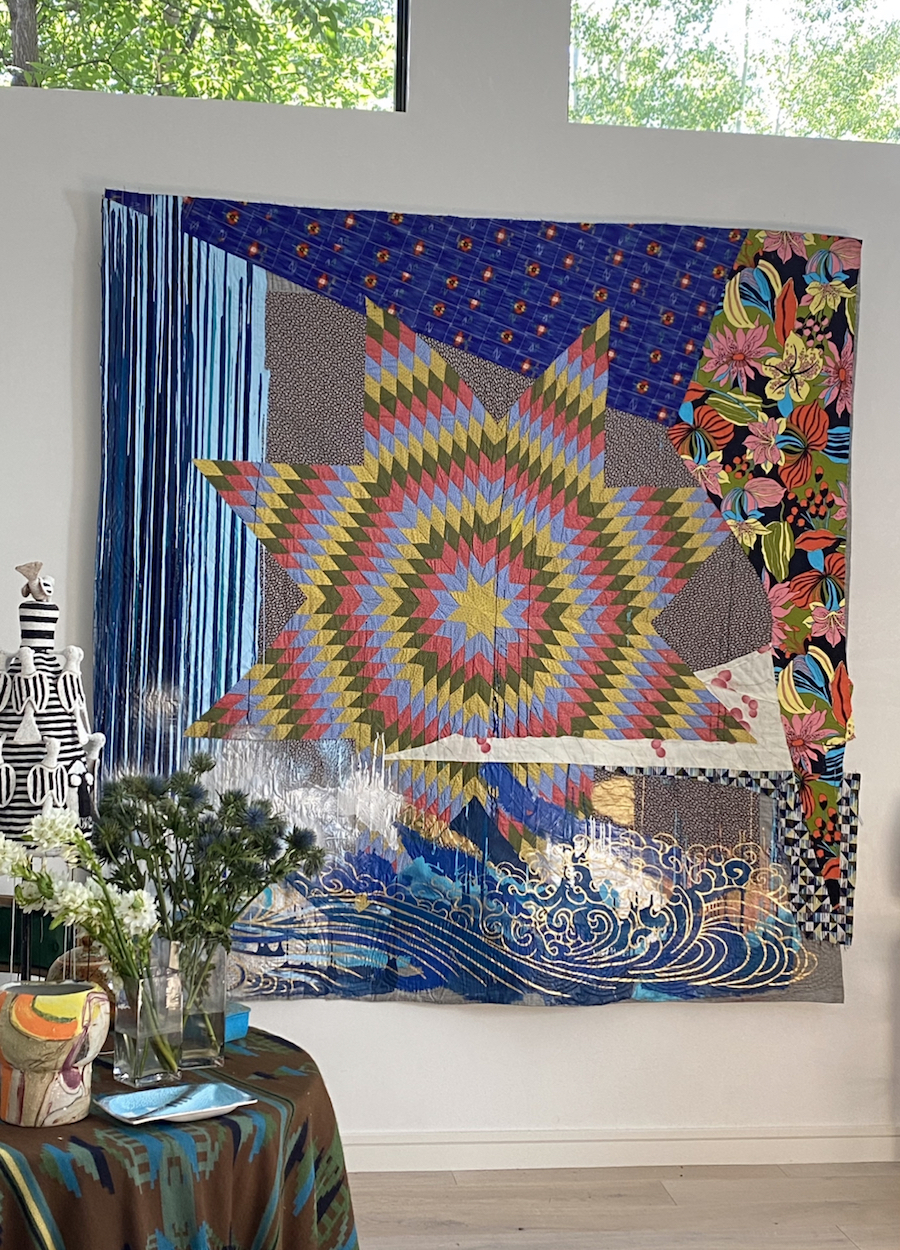 sanford biggers quilt hangs on the wall of jamie tisch home