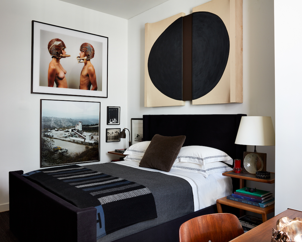 At the New York home of Robert Stilin, works by Sven Lukin (above bed); Michael Combs, Adam and Eve, 2013; Pablo Lopez, Jesus del Monte I, Huixquilucan, 2007; Wade Guyton, Untitled (Frame), 2008; Andy Warhol, Serial Objects, 1976-1987.