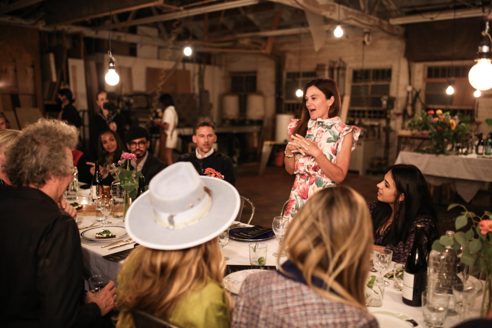 Sarah Harrelson addresses the dinner guests.