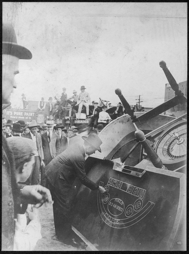 County Attorney Sumners took on organized crime and gambling in Dallas. Pictured here, he is publicly lighting gambling equipment on fire.